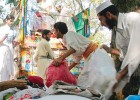 Alleged LeT front Jamaat ud-Dawa men load relief goods for quake victims in Islamabad in late 2005