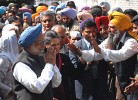 Paydirt: Farmers greet Manmohan and Sonia (left) after waiver of loans
