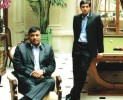 Cue up: Lakshmi Mittal with son Aditya at their £57 million London family home in Kensington Palace Gardens