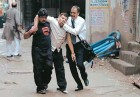 Freeze frame: Delhi Police Inspector Mohan Chand Sharma being carried out after the alleged 'encounter'