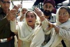 Mother of police officer Manjit Singh at the cremation ceremony of her son in Jammu, Saturday, March 15, 2003