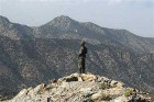 A Pakistan army soldier monitors the Afghan-Pakistan border at Kundigar post