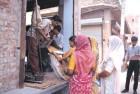Queue up Women at a Delhi ration shop