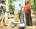 With the flow: Community taps set up in the coastal belt helped the village women