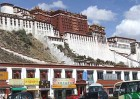 In the shadow of the absent occupant. Shops beneath Potala Palace, traditional residence of the Dalai Lamas