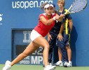 Crossed court: Sania runs down a volley