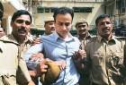 Arm of the law: Sanjeev Nanda taken into custody outside a Delhi court, Sep 2, '08