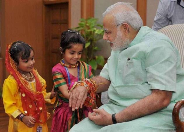 Women, Children Tie Rakhi on Modi's Wrist