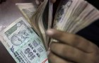 Rupee Up 3 Paise at 64.32 on Sustained Dollar-Selling