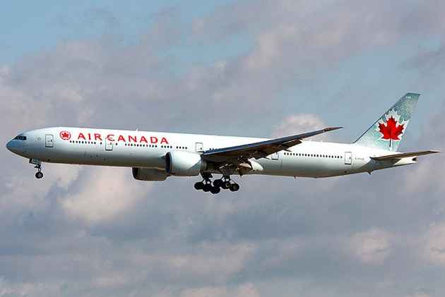 Air Canada flight diverted after man tries to open cabin door