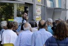 Greek Pensioners Besiege Banks to Grab Cash