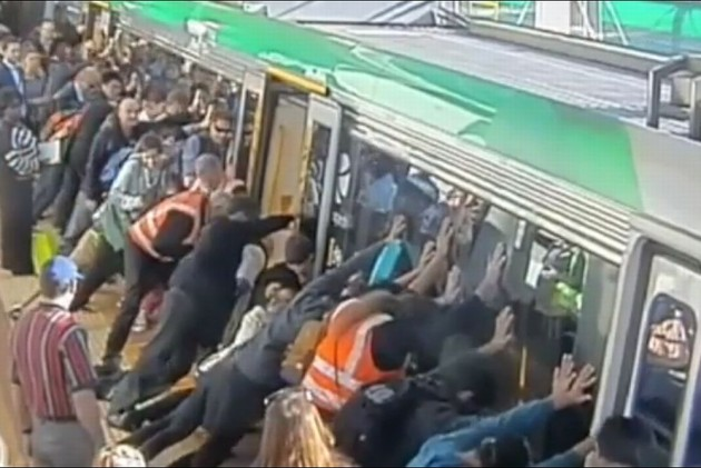 Australians Tilt Train to Free Trapped Commuter