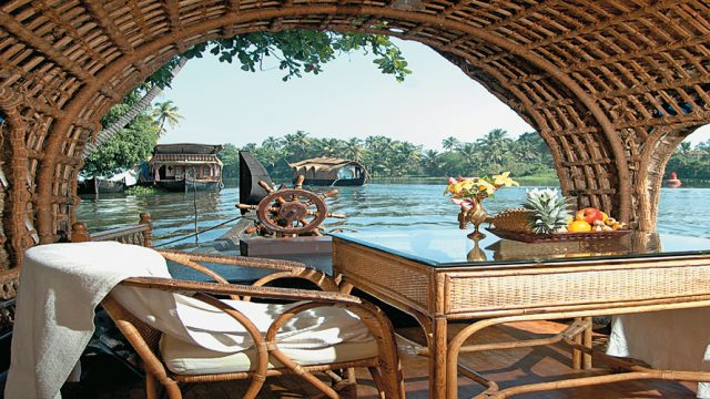 Scenic view from a houseboat, a popular way to experience the backwaters