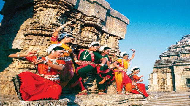 Classical dancers strike a pose at the Konark Sun Temple