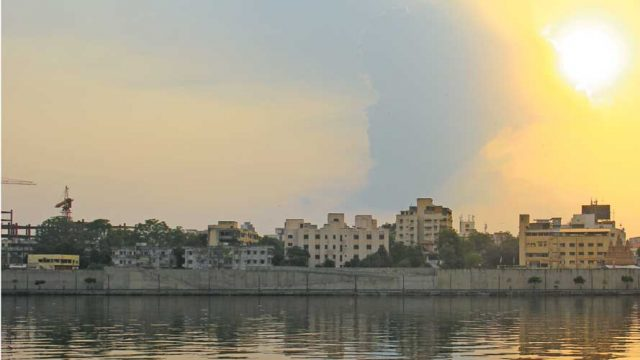 The Sabarmati river, tinged with gold in the light of the rising sun
