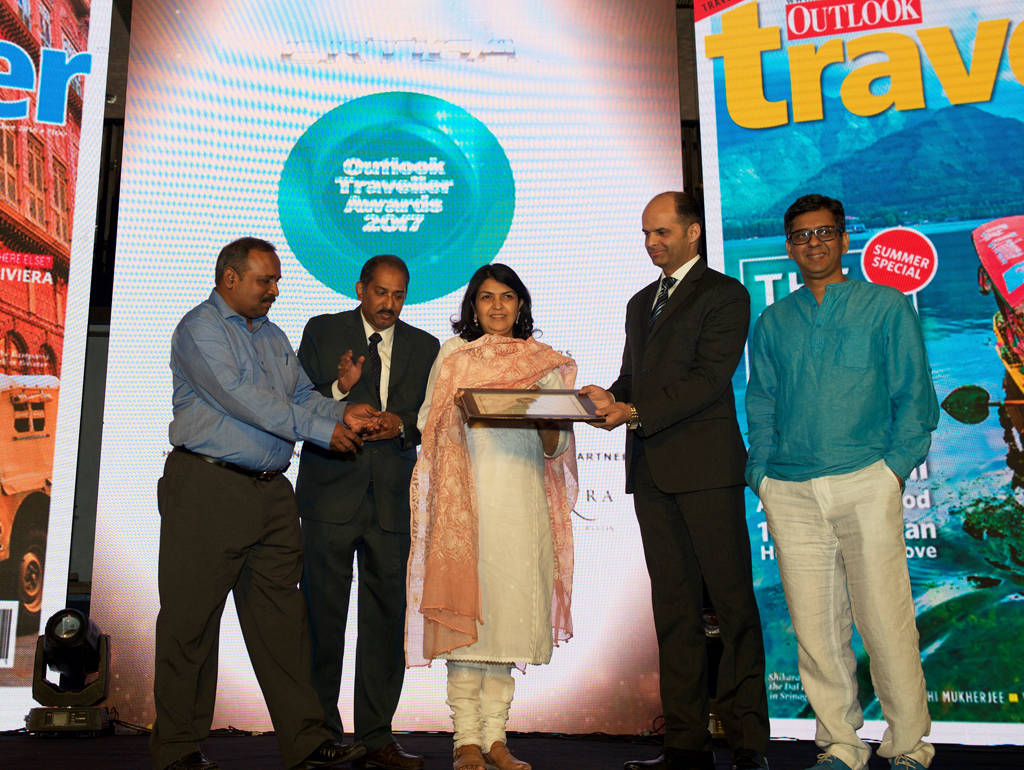 Kalyan Sengupta and D. Venkatesan, Assistant Director Generals and Aashima Mehrotra, Director, Ministry of Tourism, receive the Jury award for Best New Tourism Initiative for Ministry of Tourism's 24x7 toll-free multilingual tourist helpline