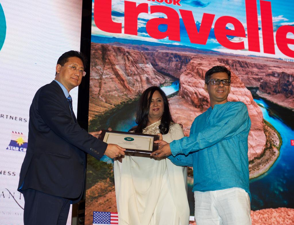 C. Apok Jamir, Parliamentary Secretary, Tourism, receives the Jury award for Best Birding Destination for Doyang Lake, Nagaland