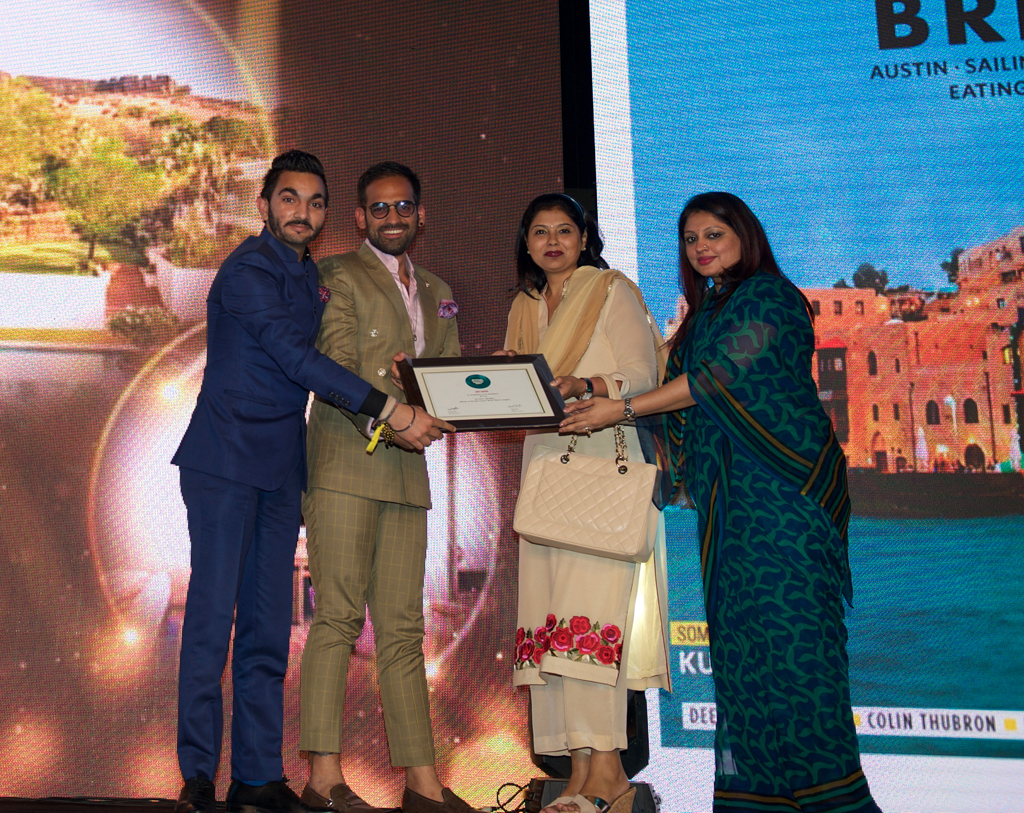 Arjun Verma, Director of Marketing & Communications and Rohan Bhasin, Director of Sales, receive the Jury award for Best Luxury Beach Resort for W Goa