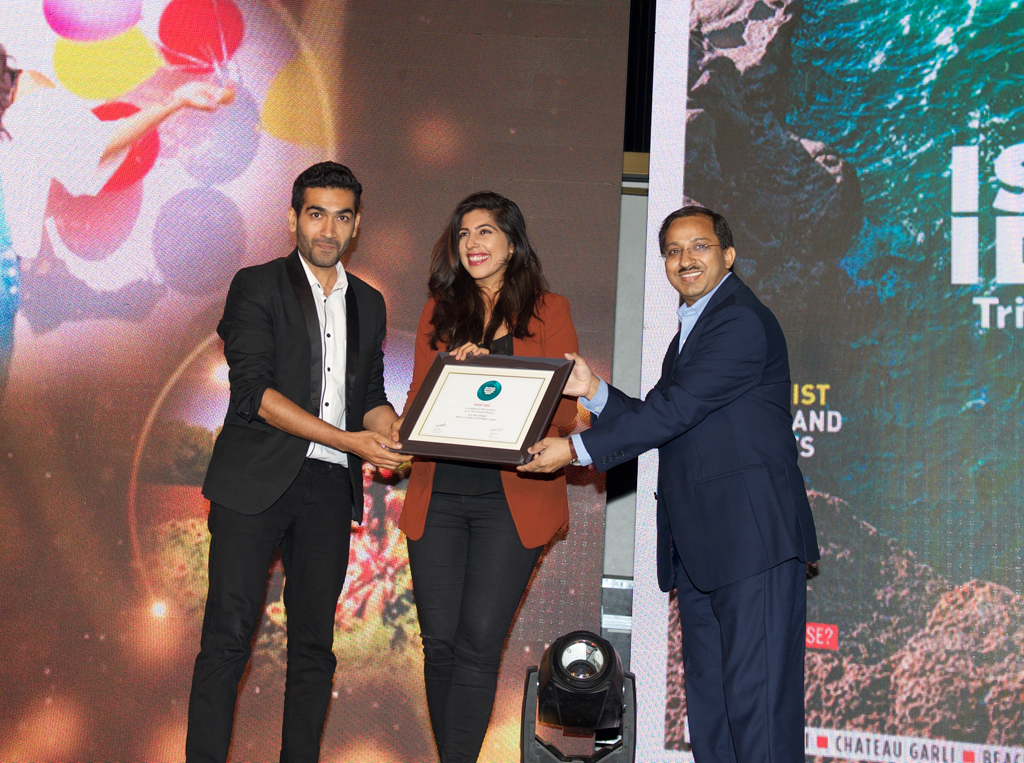 Savi & Vid, co-founders, Bruised Passports, receive the Readers' Choice award for Best Travel Blogger for Bruised Passports