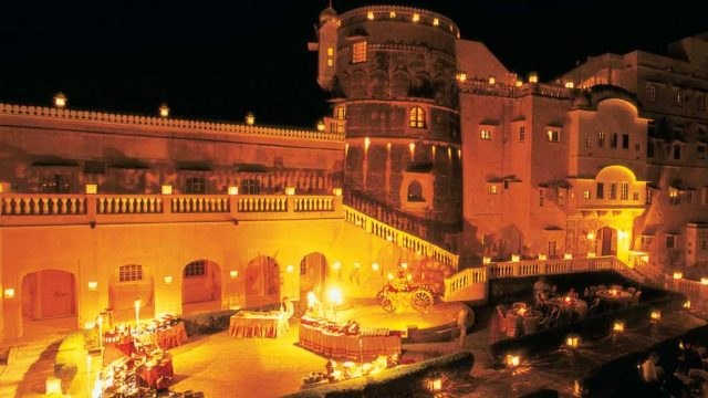 Brilliant lights set Castle Mandawa aglow at night