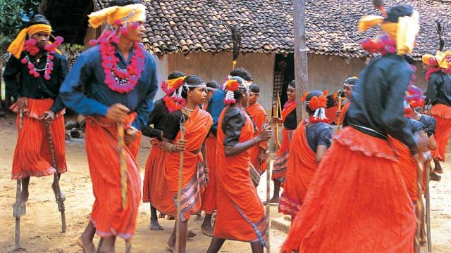 Members of the Maria tribe performing a dance in their village
