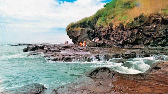 Visitors at the rocky Harihareshwar Beach