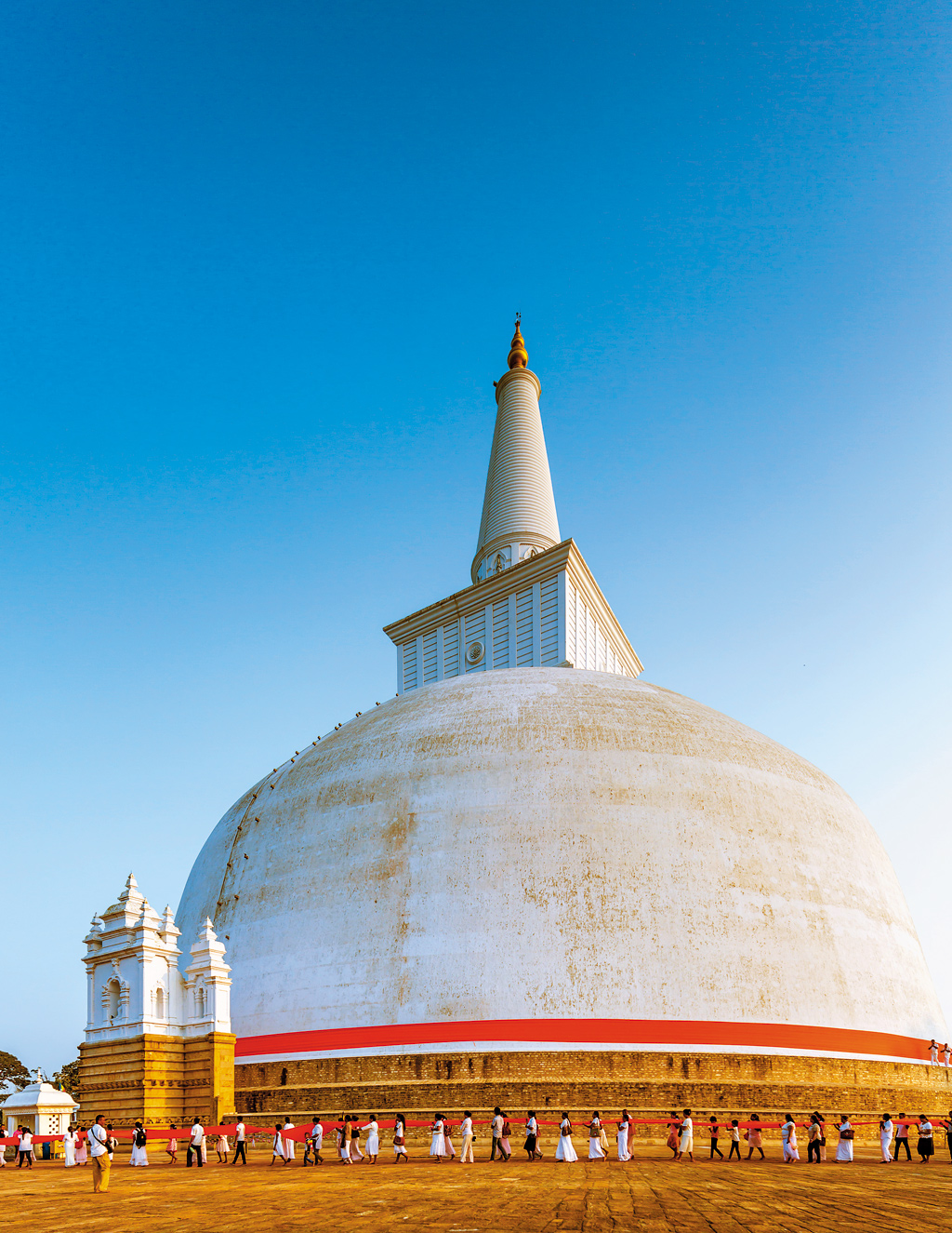 The Ruwanwelisaya Stupa in Anuradhapura, Sri Lanka. The largest stupa in Sri Lanka's first capital (4th to 11th century CE) is draped in 1,100 feet of saffron cloth 3-4 times a day. Buddha's relics are believed to be inside the stupa.