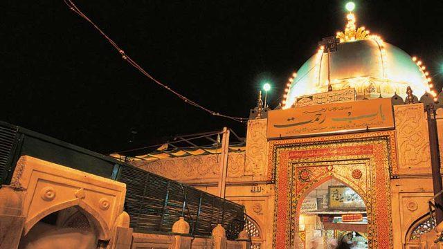 The illuminated entrance to the Dargah Sharif