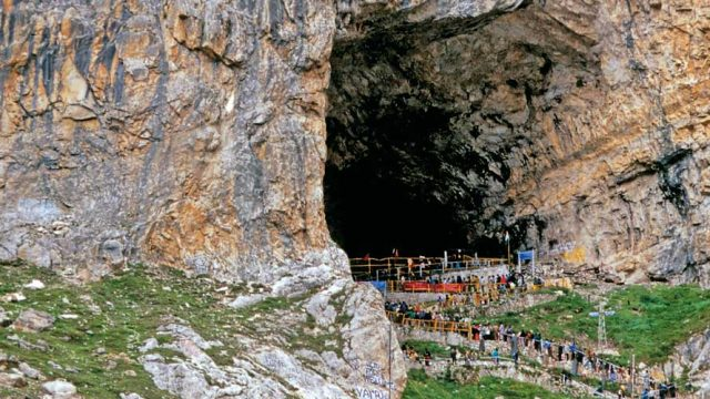 Devotees entering the mouth of the massive Amarnath cave