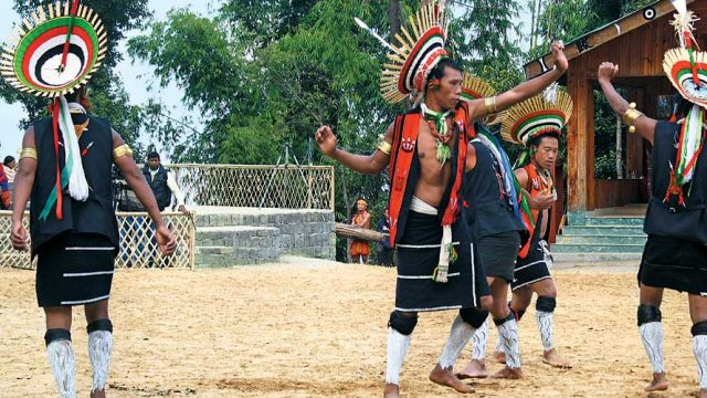 Members of a Naga tribe performing a traditional dance