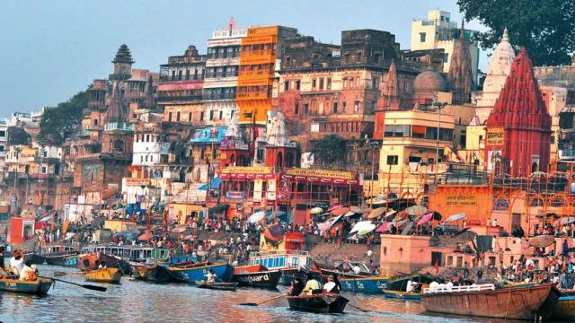 Pilgrims and visitors throng the ghats of Varanasi