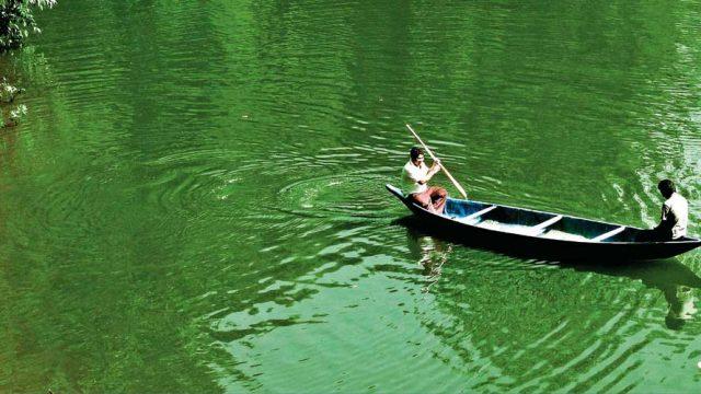 A boat on the serene waters of Ganga Lake