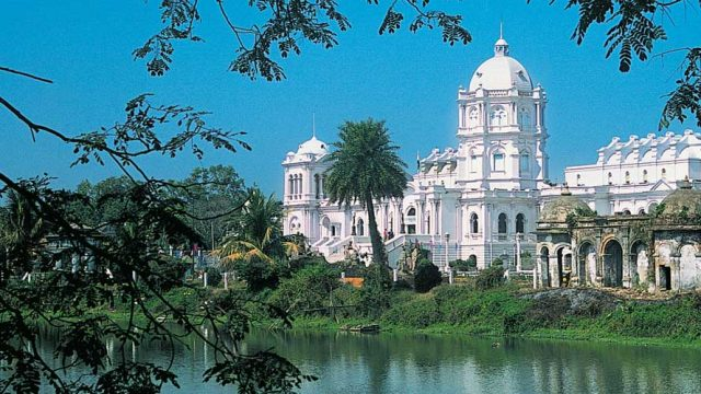 The Ujjayanta Palace set amidst verduous Mughal-style gardens