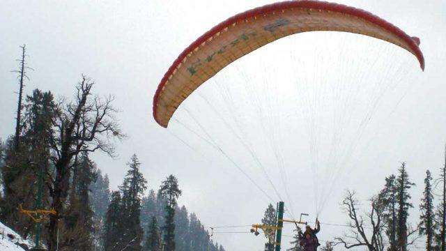 Paraglide across Manali in winter