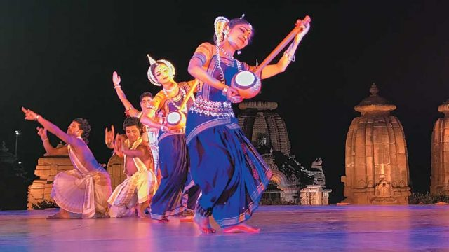 Dancers perform on stage at the Mukteswar Dance Festival
