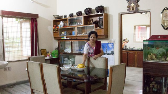 Mrs Sujata Bhagwat, the host at Gokul homestay, sets the table for breakfast