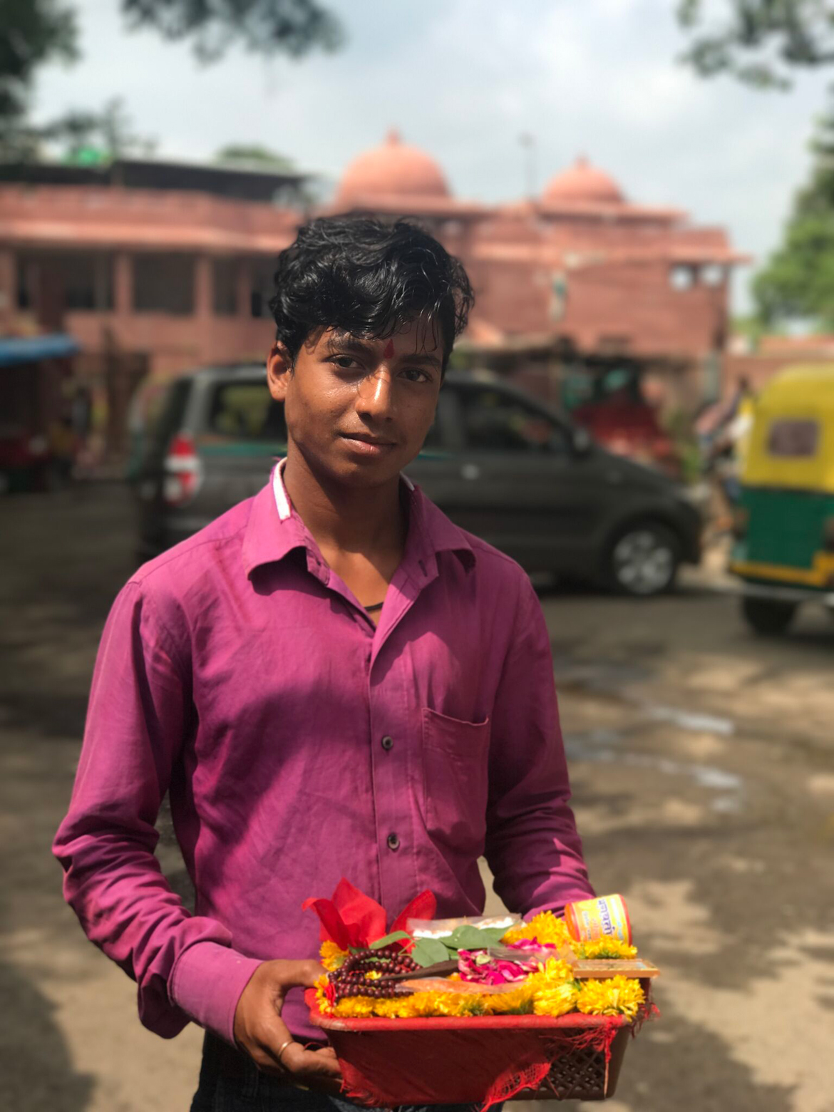 A young boy sells religious paraphernalia outside Mangalnath Temple in Ujjain