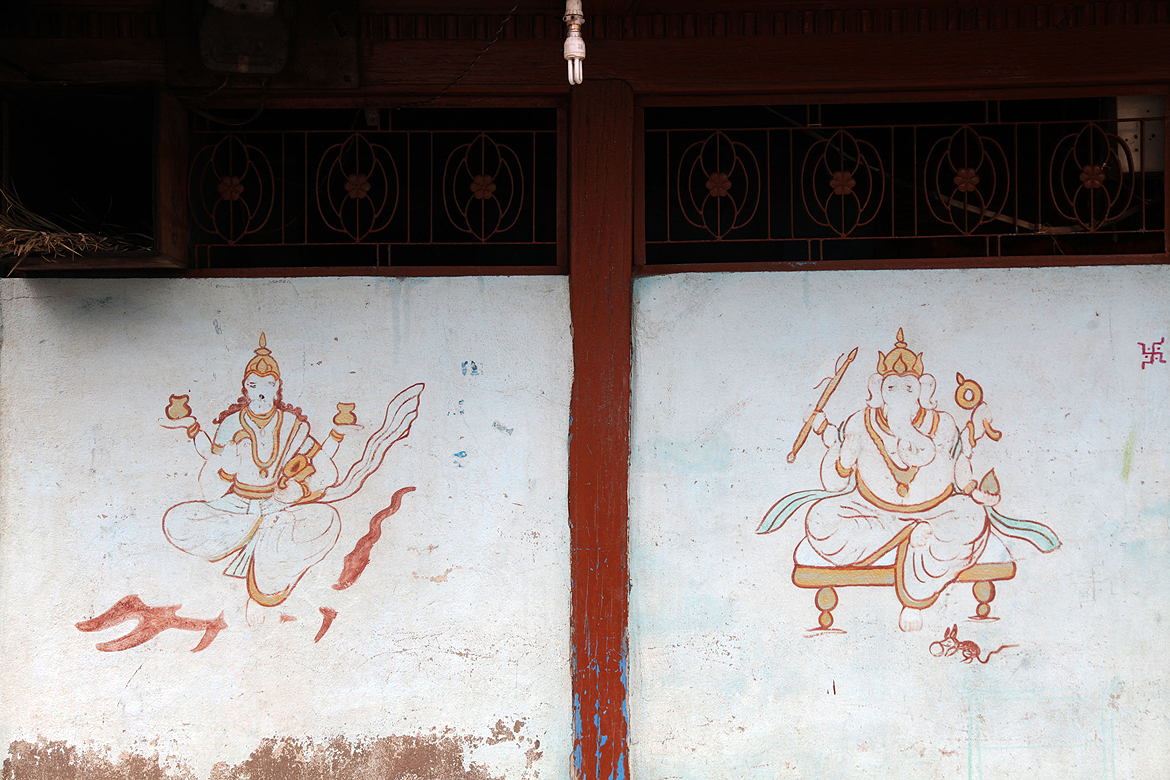 Villagers often embellish the walls of their homes with sacred imagery