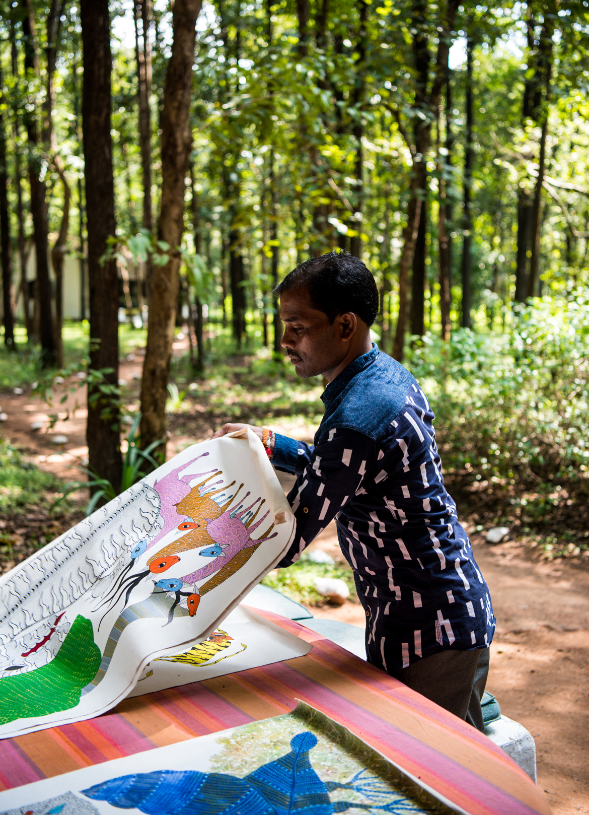 Ram Kumar Shyam, a Gond artist from Patangarh village displays his artwork.