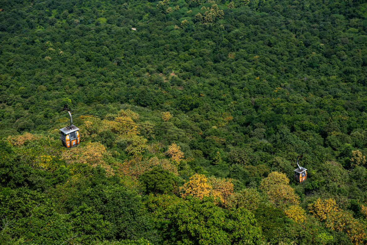 Cable cars take passengers to the top of Trikoota hill in Maihar.