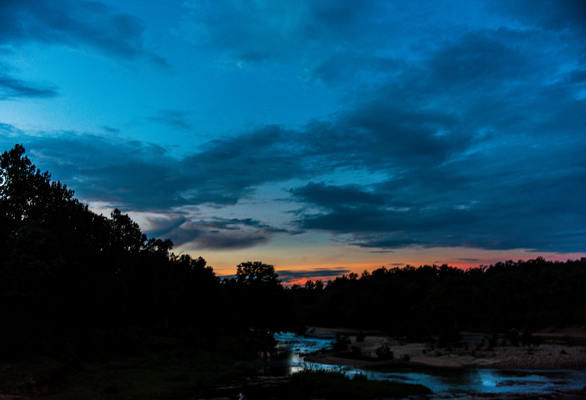 The setting sun fills the sky above Kanha with an attractive palette of swirling colours.