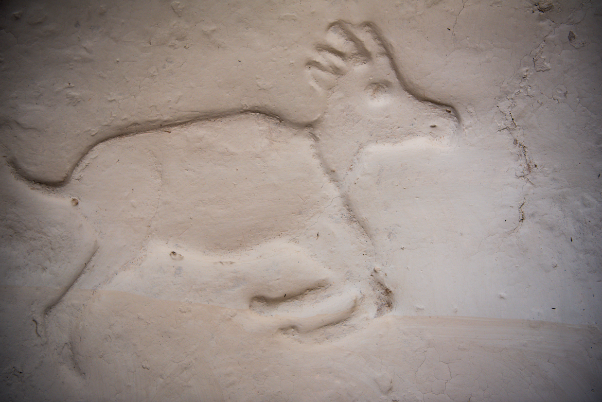 A design of a deer embellished into the wall of a home in Ichol village.