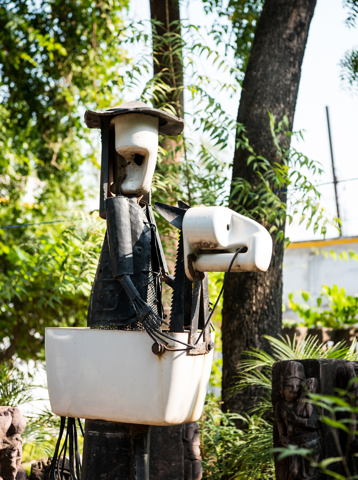 A sculpture made of iron waste and toilet seat at Maihar Heritage Home