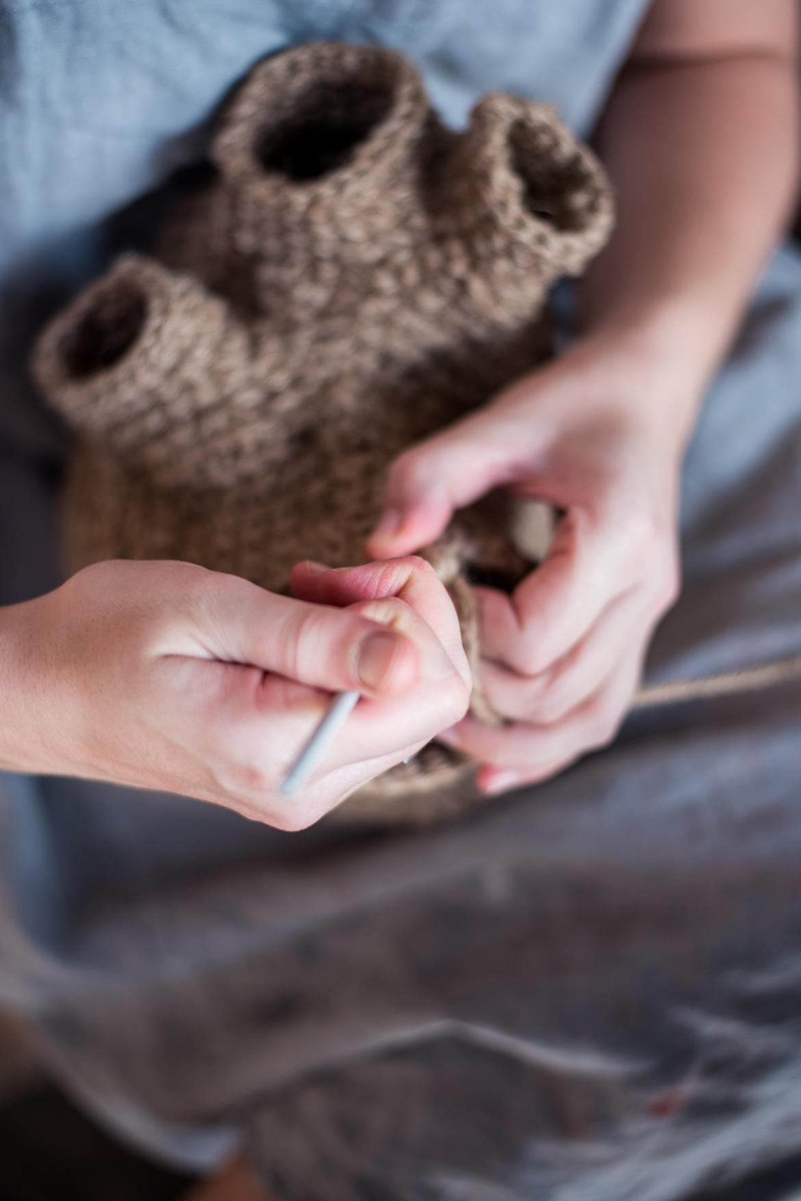 Holly Mcfeen, an artist from Freemantle Arts Centre in Australia knitting an artefact at Art Ichol
