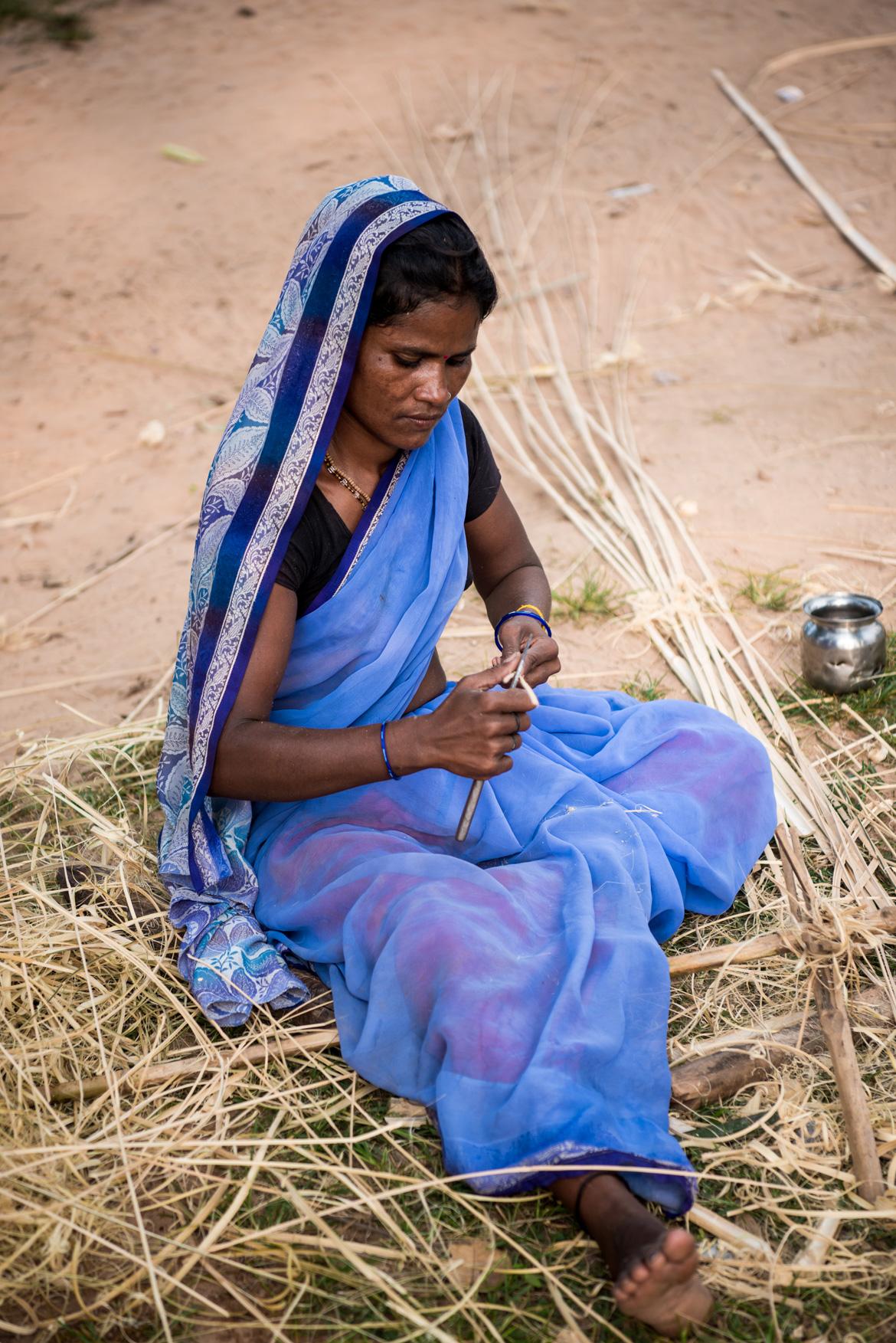 A woman making a bamboo basket in Tala village of Bandhavgarh