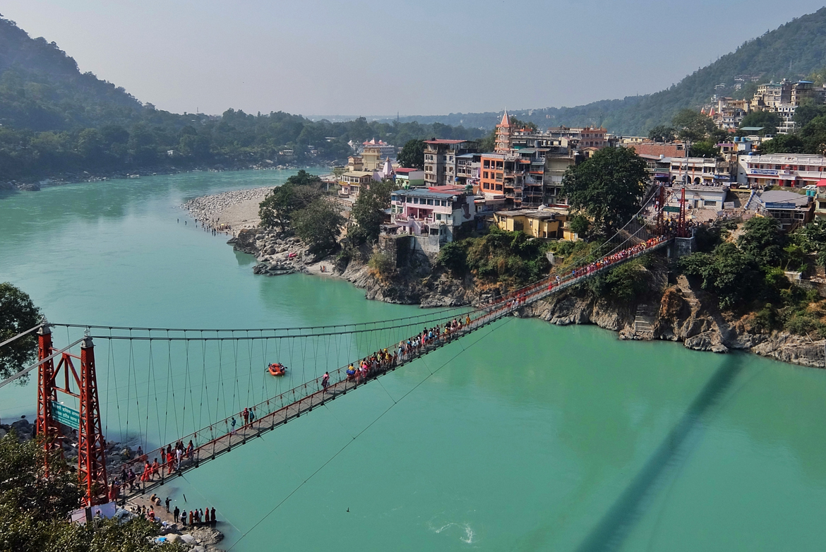 View of Ganga river and Lakshman Jhula bridge in Rishikesh