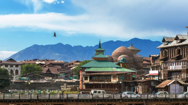 Feature Image_Riverside view of old town Srinagar from one of the bridges across Jhelum river