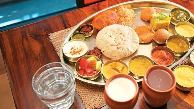 A varied combination of vegetables, lentils and breads make up a Rajasthani thali