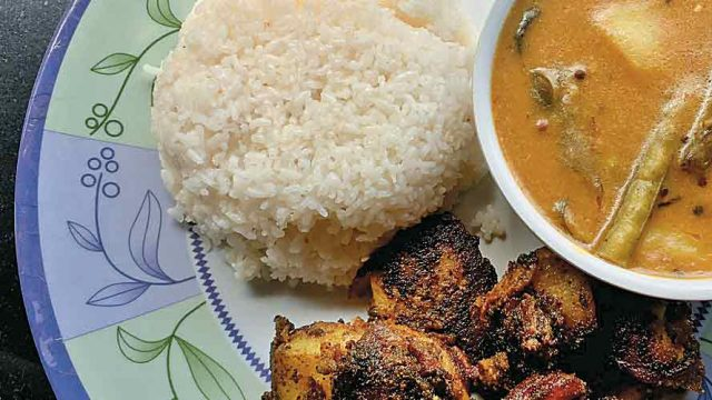 A simple and wholesome meal comprising kadhi, chawal and tuk