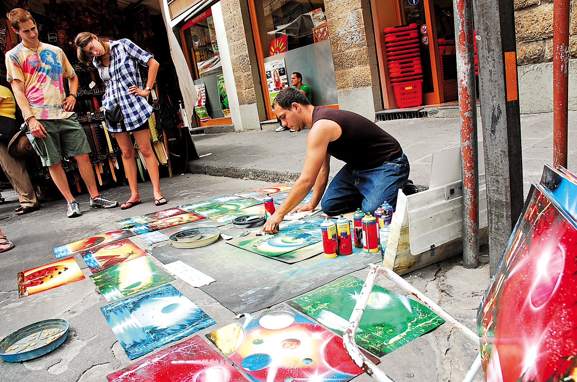 A street artist displays his collection